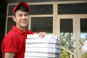 Teenager delivering pizzas